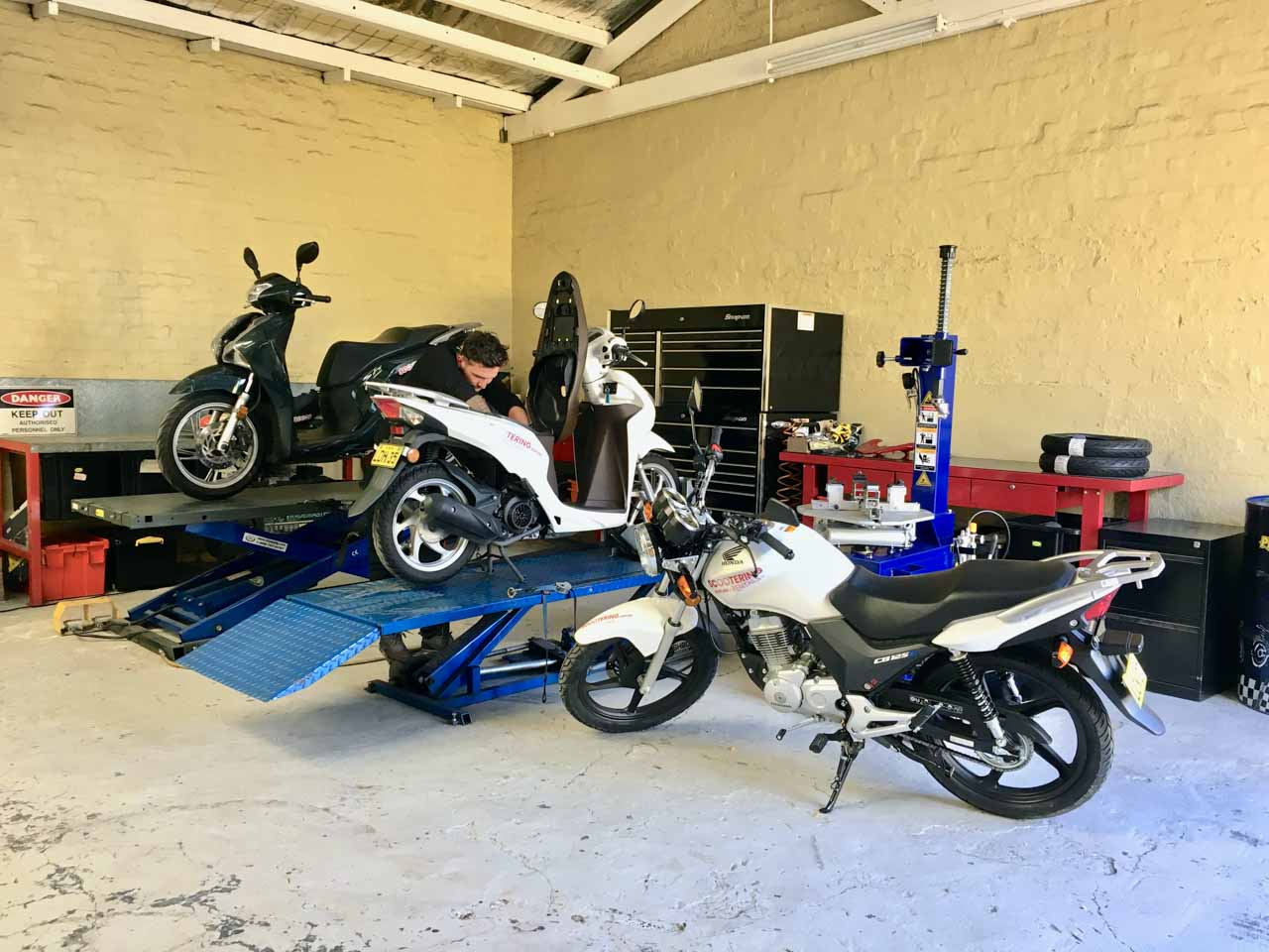 The workshop with bikes at Scootering who provide scooter and motorcycle rental in Sydney