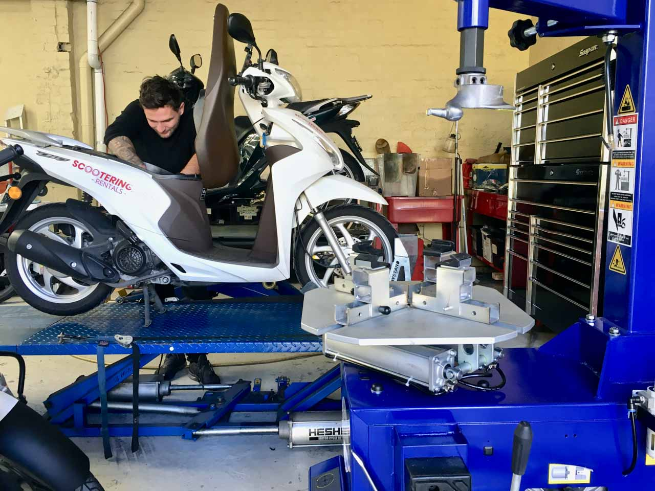 The workshop with bikes getting a service at Scootering who provide scooter and motorcycle rental in Sydney